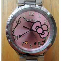 Montre Hello Kitty avec strass fond rose diametre 4cm bracelet metal